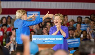 Hillary Clinton and Sen. Elizabeth Warren share a peak moment during their first campaign appearance together in Cincinnati on Monday. (Associated Press)