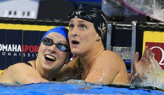 Katie Ledecky, left, reacts with Leah Smith, right, after winning the women's 400-meter freestyle final at the U.S. Olympic swimming trials in Omaha, Neb., Monday, June 27, 2016. (AP Photo/Orlin Wagner)