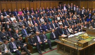 In this image taken from the Parliamentary Recording Unit Britain's Prime Minister, David Cameron, centre right, addresses the House of Commons in London, Monday June 27, 2016, regarding the result of the referendum vote on leaving the EU which took place Thursday.  Cameron advised the house that the United Kingdom will not trigger formal EU exit talks at this stage. (Parliamentary Recording Unit via AP) TV OUT  NO SALES
