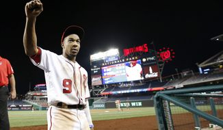 Washington Nationals' Ben Revere reacts as he comes off the field after a baseball game against the New York Mets at Nationals Park, Monday, June 27, 2016, in Washington. The Nationals won 11-4. (AP Photo/Alex Brandon)