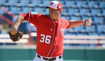 Associated Press Washington Nationals Sammy Solis pitches in an intrasquad baseball game at a spring training workout, Sunday, Feb. 28, 2016, in Viera, Fla. (AP Photo/John Raoux)
