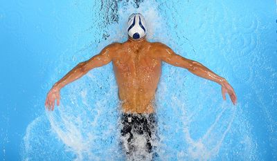 Michael Phelps swims in the men's 200-meter butterfly preliminaries at the U.S. Olympic swimming trials, Tuesday, June 28, 2016, in Omaha, Neb. (AP Photo/Mark J. Terrill)