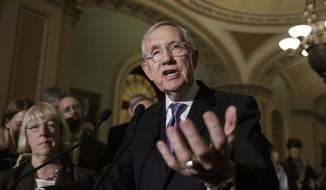 Senate Minority Leader Harry Reid of Nevada and Sen. Patty Murray (left), Washington Democrat, face reporters on Capitol Hill in Washington on June 28, 2016, as the Senate split along party lines and left a $1.1 billion proposal to fight the Zika virus in limbo. (Associated Press) **FILE**