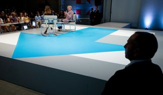 Members of the Secret Service stand nearby as Democratic presidential candidate Hillary Clinton, center, accompanied by Dulce Candy, left, speaks at a Digital Content Creators Town Hall at the Neuehouse Hollywood in Los Angeles, Tuesday, June 28, 2016. (AP Photo/Andrew Harnik)