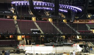 Work continues on the main stage for the Republican National Convention, Tuesday, June 28, 2016, in Cleveland. (AP Photo/Mark Gillispie)
