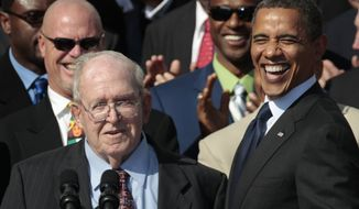 FILE - In this Oct. 7, 2011, file photo, President Barack Obama, right, smiles at former defensive coordinator Buddy Ryan, speaking left, as he stands with the 1985 Super Bowl XX Champions Chicago Bears football team during a ceremony on the South Lawn of the White House in Washington. Buddy Ryan, who coached two defenses that won Super Bowl titles and whose twin sons Rex and Rob have been successful NFL coaches, died Tuesday, June 28, 2016. He was 82. (AP Photo/Pablo Martinez Monsivais, File)