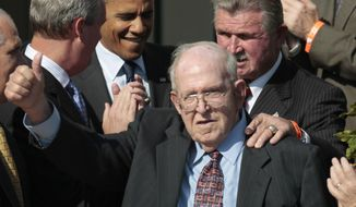 FILE - In this Oct. 7, 2011, file photo, former Bears' defensive coordinator Buddy Ryan gestures as he walks in with former head coach Mike Ditka, and President Barack Obama, during an event honoring the 1985 Super Bowl XX Champions Chicago Bears football team on the South Lawn of the White House in Washington. Buddy Ryan, who coached two defenses that won Super Bowl titles and whose twin sons Rex and Rob have been successful NFL coaches, died Tuesday, June 28, 2016. He was 82. (AP Photo/Pablo Martinez Monsivais, File)