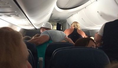 Former NFL quarterback Tim Tebow prayed with a family aboard a Delta Air Lines flight Sunday as crew helped a man suffering an apparent heart attack. (Facebook/Richard V. Gotti)