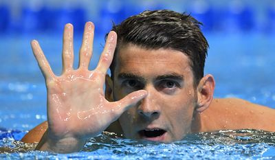 Michael Phelps gestures after winning the men's 200-meter butterfly at the U.S. Olympic swimming trials, Wednesday, June 29, 2016, in Omaha, Neb. Phelps qualified for his fifth Summer Games. (AP Photo/Mark J. Terrill)