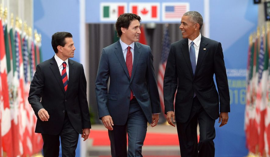 Prime Minister Justin Trudeau, center, Mexican President Enrique Pena Nieto, left, and U.S. President Barack Obama take part in the North American Leaders' Summit at the National Gallery of Canada in Ottawa on Wednesday, June 29, 2016. (Sean Kilpatrick/The Canadian Press via AP)