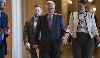 Senate Majority Leader Mitch McConnell of Ky. walks to the Senate chamber on Capitol Hill in Washington, Wednesday, June 29, 2016, as the Senate works on a rescue package for debt-stricken Puerto Rico, just two days before the island is expected to default on a $2 billion debt payment. The bill, passed by the House earlier this month, would create a control board that would oversee the island's finances and could supervise some debt restructuring. (AP Photo/J. Scott Applewhite)