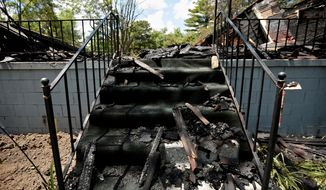 In this Tuesday, June 28, 2016 photo, burnt rubble lies on a staircase of a home destroyed by a fire in Detroit. Several houses owned by a church, which were recently renovated to house homeless people, were destroyed by the fire. (Salwan Georges/Detroit Free Press via AP)  DETROIT NEWS OUT; TV OUT; MAGS OUT; NO SALES; MANDATORY CREDIT DETROIT FREE PRESS