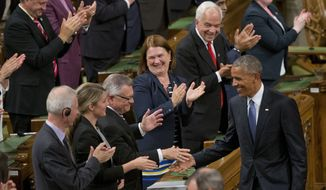 President Barack Obama, right, shakes hands before addressing the Canadian Parliament in the House of Commons in Ottawa, Canada, Wednesday, June 29, 2016. (AP Photo/Pablo Martinez Monsivais)