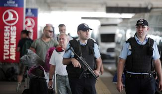 Turkish police officers patrol outside Istanbul's Ataturk airport, Wednesday, June 29, 2016. Suicide attackers killed dozens and wounded scores of others at Istanbul's busy Ataturk Airport late Tuesday, the latest in a series of bombings to strike Turkey in recent months. Turkish authorities have banned distribution of images relating to the Ataturk airport attack within Turkey. (AP Photo/Lefteris Pitarakis)