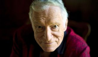 American magazine publisher, founder and Chief Creative Officer of Playboy Enterprises, Hugh Hefner is shown here at his home at the Playboy Mansion in Beverly Hills, California, in this October 2013 file photo.  (AP Photo/Kristian Dowling)