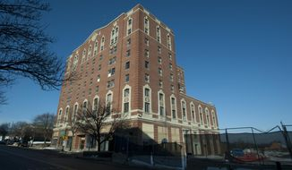 A Feb. 13, 2015 photo shows the Hayes Hotel in Jackson, Mich. An agreement between the Jackson City Council and a southeastern Michigan developer for the rehabilitation of Hayes Hotel unanimously passed and was signed at the Tuesday, June 28, 2016, council meeting. (J. Scott Park/Jackson Citizen Patriot-MLive.com via AP)