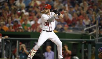 Washington Nationals' Bryce Harper bats during the third inning of a baseball game against the New York Mets, Tuesday, June 28, 2016, in Washington. (AP Photo/Nick Wass)