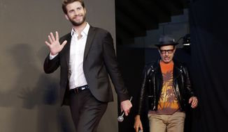 "Actors Liam Hemsworth, left, and Jeff Goldblum walk in the stage during a promotional event for the movie ""Independence Day: Resurgence"" in Tokyo, Thursday, June 30, 2016. Mr. Hemsworth was named by PETA on July 7 as the sexiest male vegetarian celebrity of 2016 (AP Photo/Eugene Hoshiko)"