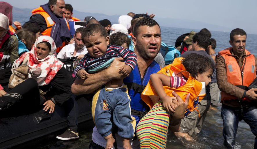 Syrian refugees arrive aboard a dinghy after crossing from Turkey to the island of Lesbos, Greece, on Sept. 10, 2015. (Associated Press)