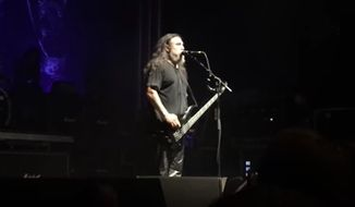 Tom Araya, frontman of the California thrash metal band Slayer, opened up a song in Switzerland Monday night by advocating for private gun ownership. (YouTube/@)Rockville PL)