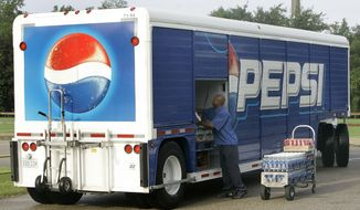In this Oct. 6, 2009, file photo, Antwain Anderson works his route delivering Pepsi products. PepsiCo announced June 29, 2016, that it is re-releasing Crystal Pepsi for eight weeks beginning on August 8, 2016. (AP Photo/Phil Coale, File) **FILE**