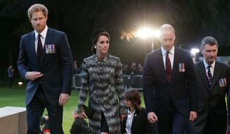 Britain's Prince William, Kate, Duchess of Cambridge and Prince Harry, left, attend a military-led vigil on the eve of the centenary of the Battle of the Somme at the Thiepval Memorial in France, where 70,000 British and Commonwealth soldiers are commemorated, Thursday June 30, 2016. (Yui Mok/Pool via AP)