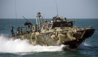 In this Oct. 26 2015, photo provided by the U.S. Navy, Riverine Command Boat (RCB) 802, assigned to Combined Task Group (CTG) 56.7, conducts patrol operations in the Persian Gulf. (Torrey W. Lee/U.S. Navy via AP) ** FILE **