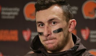 FILE - In this Dec. 20, 2015, file photo, Cleveland Browns quarterback Johnny Manziel speaks with media members following the team's 30-13 loss to the Seattle Seahawks in an NFL football game, in Seattle. Manziel has been suspended for the first four games of next season for violating the NFL's substance-abuse policy.The suspension announced Thursday, June 30, 2016, is not related to the NFL's domestic violence policy, but the free agent quarterback would be subject to it if he signs with another team. (AP Photo/Scott Eklund, File)