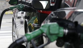 Nozzles pump gas into vehicles at a BP gas station, Thursday, June 30, 2016, in Hoboken, N.J. New Jersey Sen. Paul Sarlo, the budget committee chairman, said the Senate is not set to take any action Thursday on legislation to hike the gas tax by 23 cents while cutting the sales tax. (AP Photo/Julio Cortez)