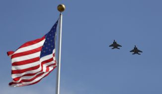 The Oregon Air National Guard conducts an F-15 flyover during the opening ceremonies at the Olympic Track and Field Trials, Friday, July 1, 2016, in Eugene Ore. (AP Photo/Charlie Riedel)