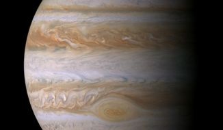 This composite image of photographs made by NASA's Cassini spacecraft on Dec. 29, 2000 shows the planet Jupiter. The photographs taken during the Cassini's closest approach to the gas giant at a distance of approximately 10 million kilometers (6.2 million miles). The Great Red Spot, a fierce storm larger than Earth, has been observed for centuries. But in recent years, it has been mysteriously shrinking. (NASA/JPL/Space Science Institute via AP)
