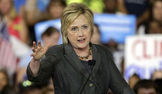 Democratic presidential candidate Hillary Clinton gestures as she speaks during a rally in Raleigh, N.C., in this June 22, 2016, file photo. (AP Photo/Chuck Burton)