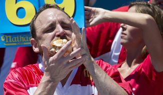 Joey Chestnut competes in Nathan's Famous Fourth of July International Hot Dog Eating Contest men's competition, Monday, July 4, 2016, in New York. Chestnut came in first eating 70 hot dogs and buns in 10 minutes. (AP Photo/Mary Altaffer)