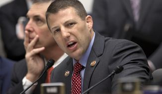 FILE - In this May 16, 2013, file photo, House Transportation and Infrastructure Full Committee member Rep. Markwayne Mullin, R-Okla. speaks on Capitol Hill in Washington. The debate over the effectiveness of self-imposed term limits arose again when Mullin appeared noncommittal about leaving Congress in 2018 despite a pledge to serve only serve six years. (AP Photo/Carolyn Kaster, File)