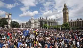 """Remain"" supporters demonstrate in Parliament Square, London, to show their support for the European Union in the wake of the referendum decision for Britain to leave the EU, known as ""Brexit"", Saturday July 2, 2016. Demonstrators wearing EU flags as capes and with homemade banners saying ""Bremain"" and ""We Love EU"" gathered on the streets for the March for Europe rally. At rear right is the Elizabeth Tower containing Big Ben. Associated Press photo"