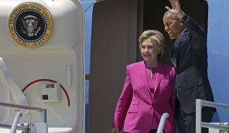 President Barack Obama waves as he and Democratic presidential candidate Hillary Clinton get off Air Force One in Charlotte, NC, Tuesday, July 5, 2016, for a campaign rally. (AP Photo/Bob Leverone)