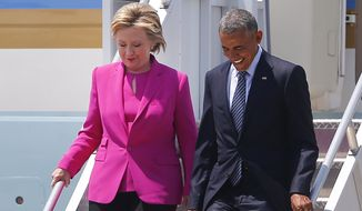 President Barack Obama and Democratic presidential candidate Hillary Clinton arrive Tuesday, July 5, 2016, in Charlotte, N.C. for a campaign rally. (AP Photo/John Bazemore)