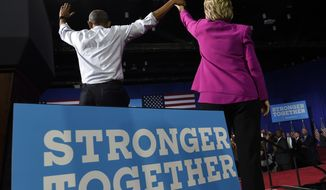 President Barack Obama and Democratic presidential candidate Hillary Clinton wave following a campaign event at the Charlotte Convention Center in Charlotte, N.C., Tuesday, July 5, 2016. Obama is spending the afternoon campaigning for Clinton. (AP Photo/Susan Walsh)