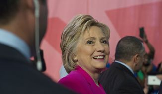 Democratic presidential candidate Hillary Clinton leaves after addressing the the National Education Association (NEA) Representative Assembly in Washington, Tuesday, July 5, 2016. (AP Photo/Molly Riley)