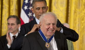 In this Nov. 24, 2014, file photo, President Barack Obama awards former Illinois Rep. Abner Mikva the Presidential Medal of Freedom during a ceremony in the East Room of the White House in Washington. Mikva, a former congressman, Illinois legislator, federal appellate judge and presidential adviser, died Monday, July 4, 2016. He was 90 years old. (AP Photo/Jacquelyn Martin, File)