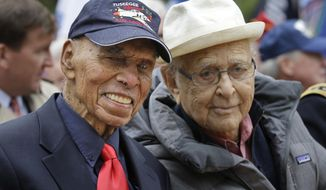 In this Nov. 11, 2015 photo, Tuskegee Airmen Roscoe Brown Jr., left, and TV writer/producer Norman Lear pose for a picture before the annual Veteran's Day parade in New York. Brown, who served with the all-black Tuskegee Airmen during World War II and was a longtime New York City educator, died Saturday, July 3, 2016, at a hospital in the Bronx. He was 94. (AP Photo/Seth Wenig, File)