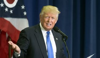 Republican presidential candidate Donald Trump reacts as he speaks about former Secretary of State Hillary Clinton's email issues during a campaign rally at the Sharonville Convention Center, Wednesday, July 6, 2016, in Cincinnati. (AP Photo/John Minchillo)
