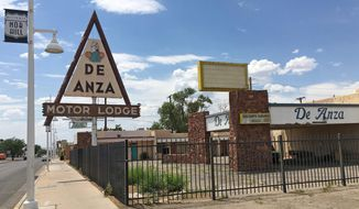 In this June 24, 2016, photo, the closed De Anza Motor Lodge sits along Route 66 in Albuquerque, N.M., and recently has been highlighted as one of the few places that allowed black travelers to stay during segregated times. (AP Photo/Russell Contreras)