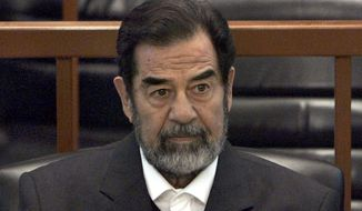 """In this Dec. 6, 2006, file photo, former Iraq leader Saddam Hussein sits in court in Baghdad, Iraq, during the """"Anfal"""" trial against him. Republican Donald Trump is again praising the former Iraqi President Hussein's ruthlessness, saying he killed terrorists """"so good."""" Trump was speaking at a rally Tuesday, July 5, 2016, in North Carolina when he turned to the former Iraqi leader. (AP Photo/Chris Hondros, Pool, File)"""