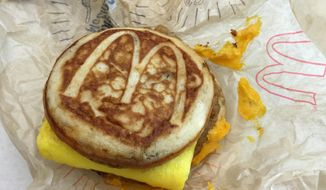 This file photo shows a McDonald's McGriddle sandwich in New York on Jan. 28, 2016. McDonald's says it will expand its all-day breakfast menu with the addition of McGriddles nationally starting in late August. The company is hoping to continue momentum from the launch of a limited all-day breakfast menu from 2015 as it tries to revive slumping sales. (Associated Press) **FILE**