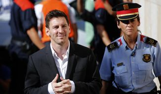 In this Sept. 27, 2013, file photo, FC Barcelona soccer player Lionel Messi, left, arrives at a court to answer questions in a tax fraud case in Gava, near Barcelona, Spain. A Barcelona court on Wednesday, July 6, 2016, sentenced Lionel Messi and his father Jorge Horacio Messi to suspended sentences of 21 months in prison each for tax fraud. The court found them guilty of three counts of tax fraud each. (AP Photo/Emilio Morenatti, File)