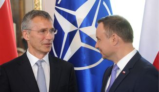 "NATO Secretary General Jens Stoltenberg (left) is welcomed by Polish President Andrzej Duda to Warsaw, which will host a two-day summit starting Friday. It is the first time Poland has hosted a top-level meeting of the Western military alliance, which it joined in 1999. The summit will be ""a defining moment for our security,"" Mr. Stoltenberg said Thursday. (Associated Press)"