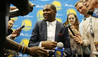 Golden State Warriors' Kevin Durant speaks with reporters after he was introduced during a news conference at the NBA basketball team's practice facility, Thursday, July 7, 2016, in Oakland, Calif. (AP Photo/Beck Diefenbach)