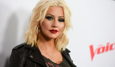 Christina Aguilera was born in Staten Island, New York, on December 18, 1980, to Shelly Loraine, a musician, and Fausto Xavier Aguilera, a United States Army soldier. Her family moved frequently because of her father's military service, and lived in places including New Jersey, Texas, New York, and Japan. Aguilera and her mother alleged that her father was physically and emotionally abusive, claims which he denied; Aguilera used music as a form of escape from her turbulent household. Following her parents' divorce when she was six years old, Aguilera, her younger sister Rachel, and her mother (who later remarried) moved into her grandmother's home in the Pittsburgh suburb of Rochester, Pennsylvania. After several years of being estranged, Aguilera expressed interest in reconciling with her father in 2012.  (Photo by Richard Shotwell/Invision/AP, File)
