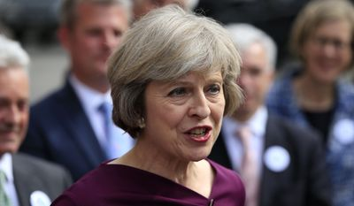 Britain's Home Secretary, Theresa May, makes a statement outside the Palace of Westminster, in London, after she won 199 votes for the Conservative leadership, Thursday July 7, 2016. Andrea Leadsom took 84 votes and Michael Gove took 46, meaning the U.K.'s next prime minister will be a woman. (Jonathan Brady/PA via AP)